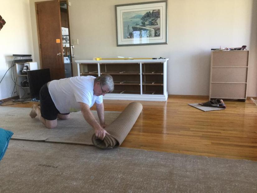 hubby removing carpet.jpg